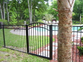 image of three-rail pool fence and pool gate